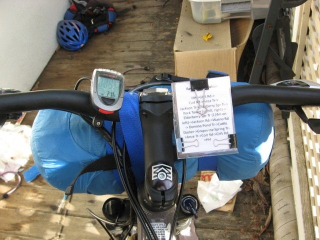 Cockpit view- Cateye 8 and route cheat sheet. Tent in blue stuff sack.