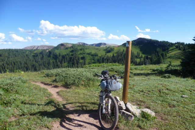Standard picture of bike leaninng against Colorado Trail marker
