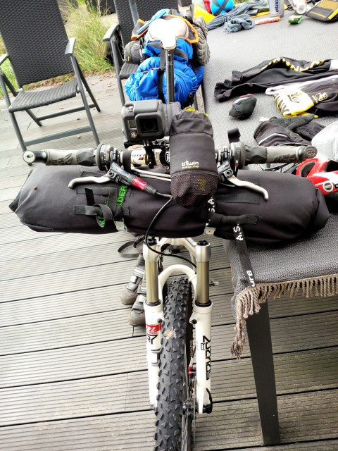 DIY handlebar bag with EMS bivy bag and Decathlon 3/4 sleeping mattress inside.